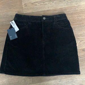 Aritzia NWT black corduroy skirt